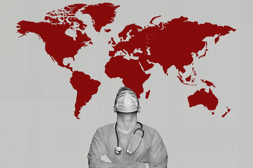 A medical professional looking up to a red colored map of the world.