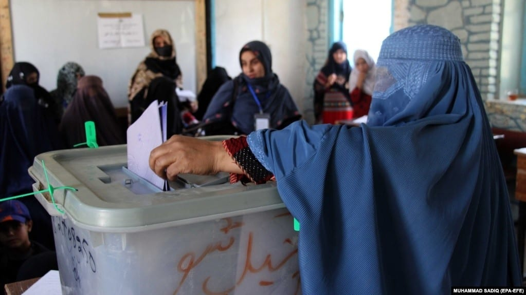 Afghan women voting for the first time in the history of their country.