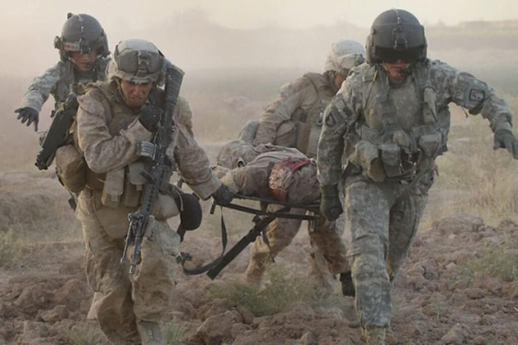 U.S. troops evacuating one of their wounded soldiers from the battlefield in Afghanistan.