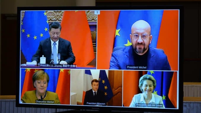 From top right: European Council President Charles Michel and Chinese President Xi Jinping From bottom right: European Commission President Ursula von der Leyen, French President Emmanuel Macron and German Chancellor Angela Merkel during a video conference on investment pact between China and the European Union.